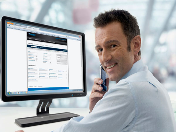 Man booking order with computer and phone